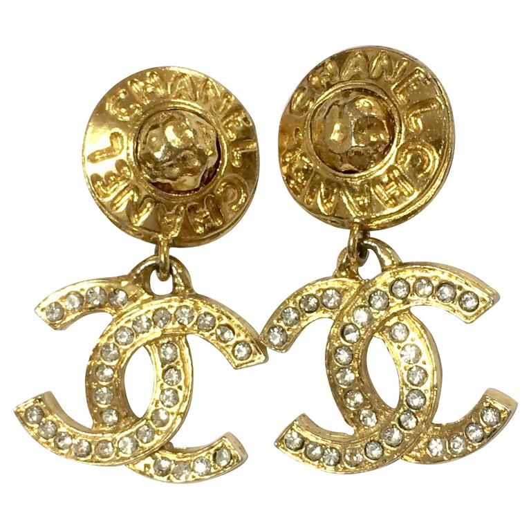 vintage chanel dangling earrings with cc and button