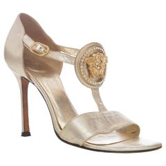 Versace Gold Leather Metalic Stiletto Medusa Head Framed With Swarovski Crystals