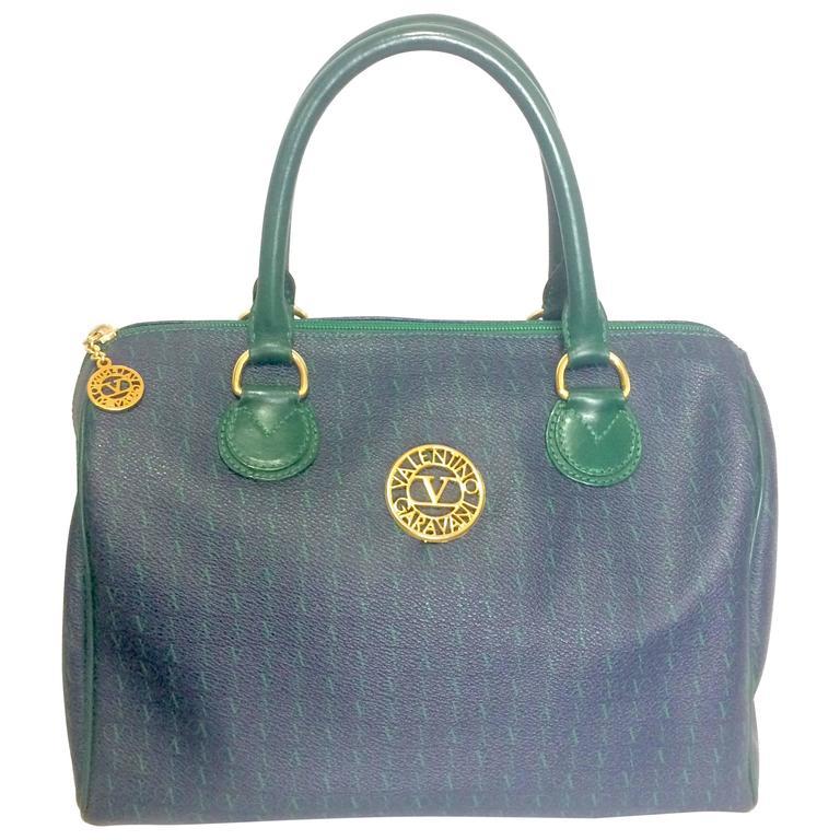 Vintage Valentino Garavani blue and green speedy handbag with logo motifs.