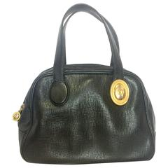 Vintage Christian Dior black leather mini bolide style handbag with logo motif.