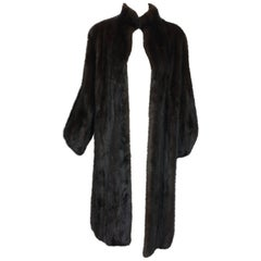 Full length lustrous dark mink coat with gathered cuffs 1960s