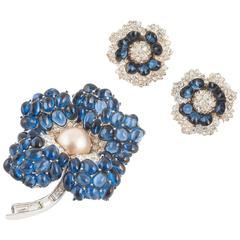 Elegant Marcel Boucher 'flower' brooch and matching earrings.