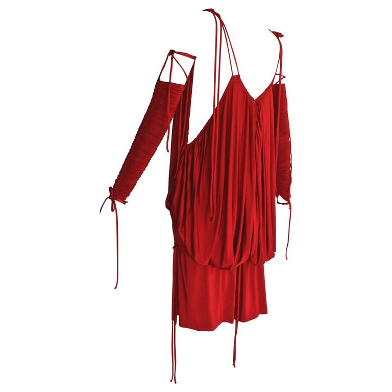 """Red, baring and slinky, this Dolce & Gabbana minidress is designed to command attention. When it debuted in the spring/summer 2003 runway show on supermodel Gisele Bündchen, it led Vogue's Sarah Mower to write, """"power-womanhood is not extinct on"""
