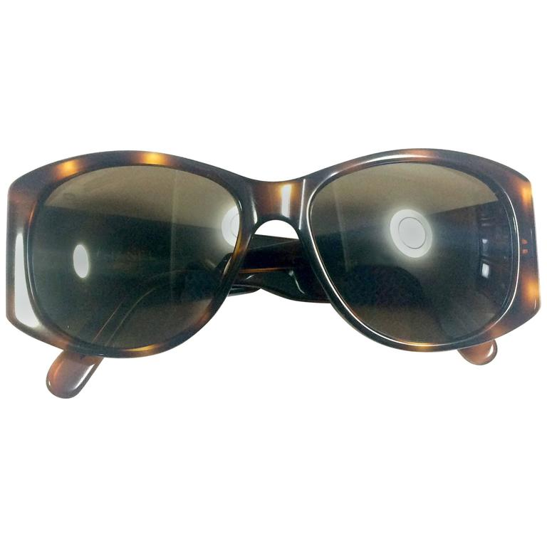 Vintage CHANEL brown frame sunglasses with large CC charms at sides. Classic. 1