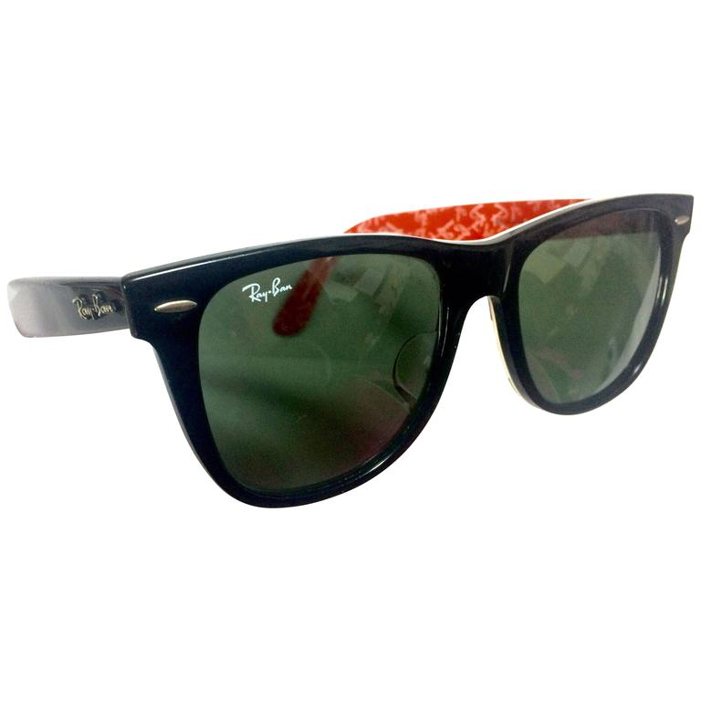 Vintage Ray Ban black frame and grey shade sunglasses with red and white logo.