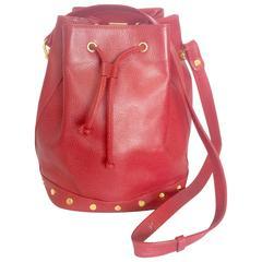 Vintage LANVIN apricot red hobo bucket shoulder bag with studded logo motifs.