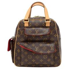 Louis Vuitton Excentri Cite Monogram Canvas Hand Bag