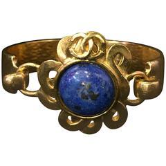 "1997 Gold-Tone Hinged Lapis Lazuli ""CC"" Logo Sun Bracelet"