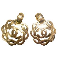 Vintage CHANEL extra large wavy round flower dangling earrings with CC mark.