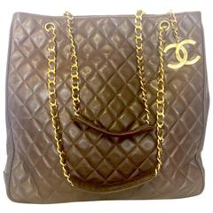 Vintage CHANEL brown lambskin large tote bag with gold tone chains and CC charm.