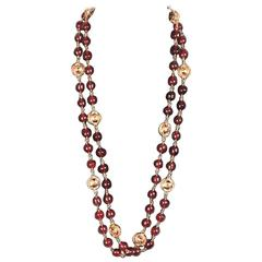 CHANEL Vintage 70s Gold metal & Burgundy Glass Beads LONG NECKLACE