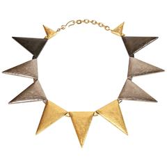 YVES SAINT LAURENT gold and silver triangular shaped numbered necklace