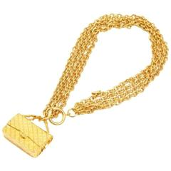 Vintage CHANEL golden multiple chain necklace with classic 2.55 bag charm.
