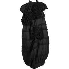 2006 COMME DES GARCONS 'tao' black dress with rosettes