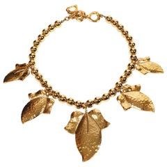 Yves Saint Laurent oversized hammered gilt leaf necklace, 1980s