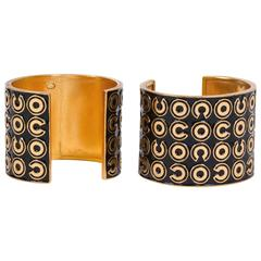 Chanel Pair of Black/Gold Cuff Bracelets