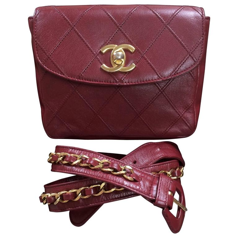 Vintage CHANEL wine leather waist purse, fanny pack with golden chain belt. 1