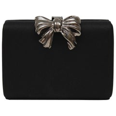 1980s Rodo Black Satin Clutch with  Metal Bow Detail