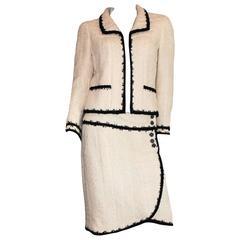 Most famous Chanel Signature Boucle Faux Wrap Skirt Suit