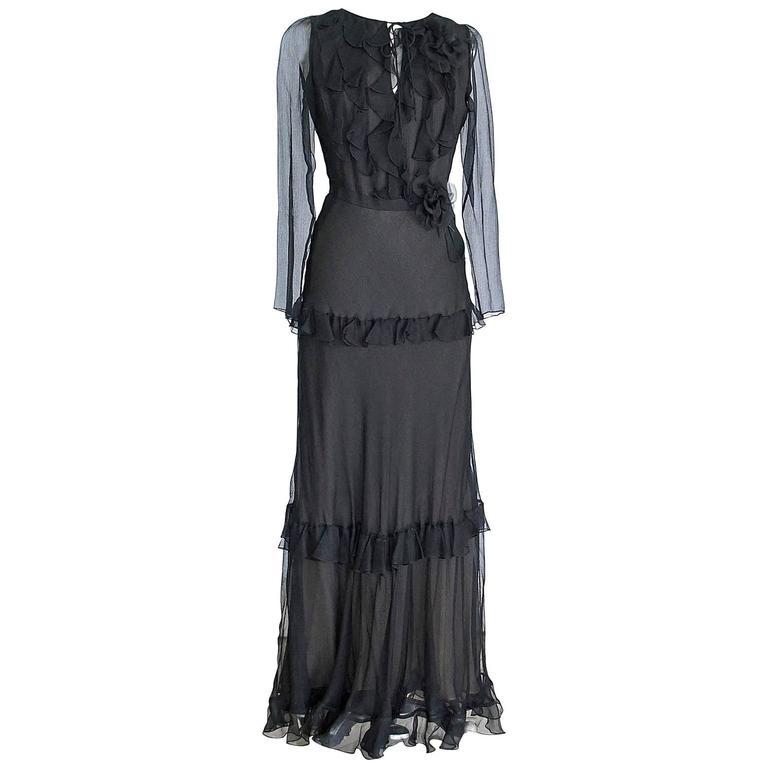 Oscar De La Renta Black Silk Chiffon Ruffle Gown Accentuated by two Flower Pins