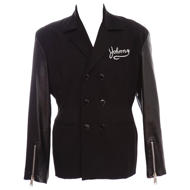 John Richmond, circa 1980's mens black double breasted wool jacket with black leather sleeves with YKK zipper pulls, left sleeve having white printed Destroy graphics, two bound front pockets, white embroider Johnny logo, slightly padded shoulder