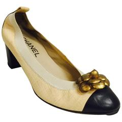 Chanel Black and Tan Pumps With Antique Gold Tone Camellia Ornaments