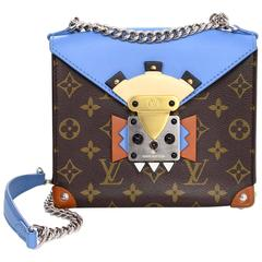 Louis Vuitton Blue and Bown Monogram Mask Pochette Crossbody Bag rt. $3,250