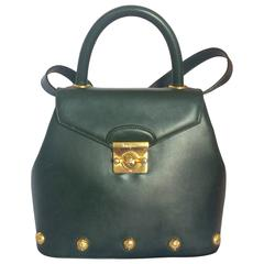 Vintage Salvatore Ferragamo deep green leather bag with gold tone motifs.