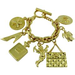 Chanel Vintage Iconic 7 Charms Gold Toned Bracelet