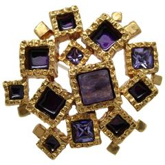 Awesome Yves Saint Laurent Golden Brooche with purple stones