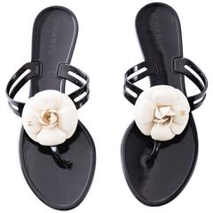 Chanel Black Jelly Slide Sandals With Cream Camellia