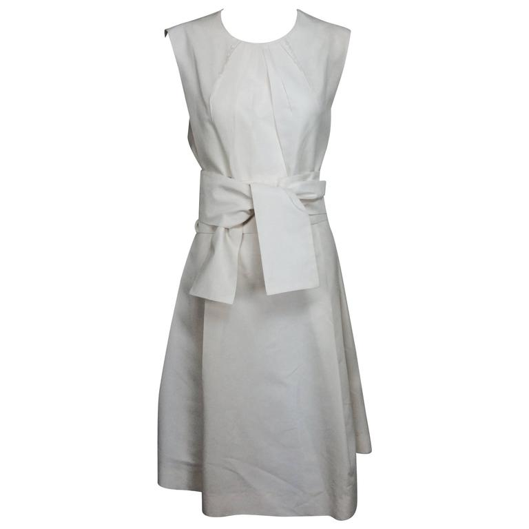 Yves Saint Laurent sleeveless creamy white cotton and silk wrap waist dress Lg.