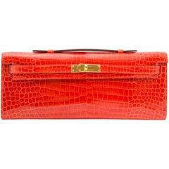 Hermès Brand New Kelly Cut Pochette Crocodile Porosus Lisse Orange