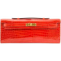 Hermès Brand New Kelly Cut Pochette Crocodile Porosus Lisse Orange