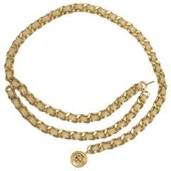 Vintage CHANEL beige leather chain belt with golden CC and mademoiselle charm.