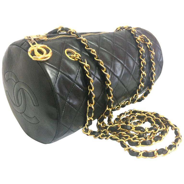 Vintage CHANEL black lamb leather golden chain shoulder bag in round drum shape. 1