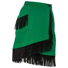 An 80s Yves Saint Laurent Bright Green Fringed Wrap Skirt