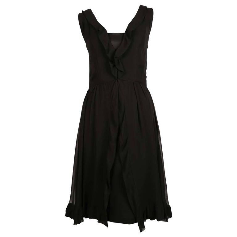 1960's JACQUES HEIM black silk dress with sheer mousseline overlay