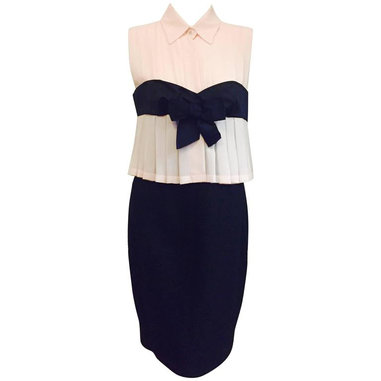 The crown jewel of Haute Couture Chanel, this classic two tone dress with bow 1