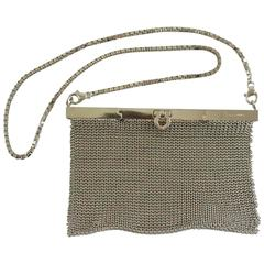 Salvatore Ferragamo Silver Mesh Bag and Clutch