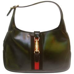Gucci Italy Iconic Black Leather Piston Jackie O Handbag ca 1970s