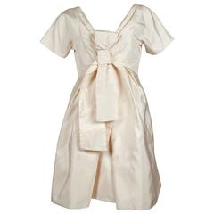 2006 ALEXANDER MCQUEEN cream silk runway dress with bow detail