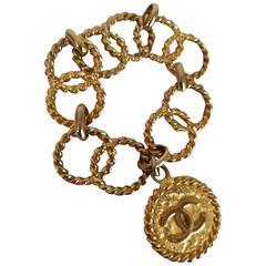 Chanel Gold tone CC Logo Pendant Bracelet