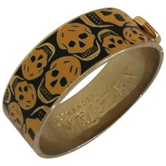 Alexander McQueen Gold tone Skulls black Bracelet