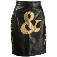 Moschino Cheap and Chic black and gold leather skirt,1990s