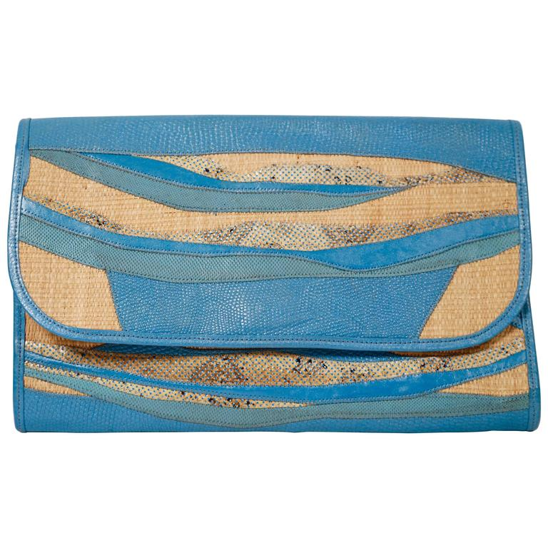 1980's CARLOS FALCHI blue patchwork convertible clutch made of reptile skins 1