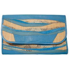1980's CARLOS FALCHI blue patchwork convertible clutch made of reptile skins