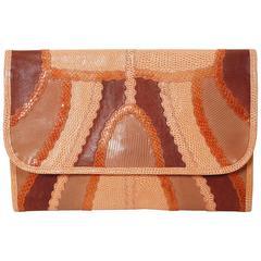 1970's CARLOS FALCHI peach patchwork reptile skin clutch