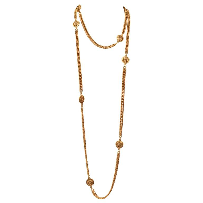 Early 1990s Chanel Gilt Long Necklace with Medallions For Sale
