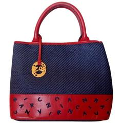 Vintage Nina Ricci navy woven straw and red leather handbag, tote bag with logo.